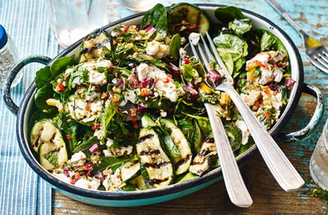 Get creative with your barbecue side dishes - parcels of creamy feta, rainbow chard, chilli and herbs are baked on the barbecue until gooey and loaded onto a bed of spinach, mint and gorgeously tender, smoky courgettes.