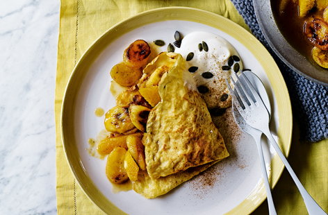 This simple gluten- and dairy-free pancake recipe means nobody has to miss out on classic crêpes this Pancake Day. Fill with golden caramelised bananas and juicy fresh orange slices for a new way to serve your pancakes this year.