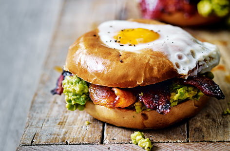 Bagels are the perfect vessel to create this Mexican-inspired egg in a hole. Jazz up rashers of crispy streaky bacon with a sweet and spicy mix of chipotle, paprika and maple syrup and serve with a zingy tomato guacamole and perfectly cooked eggs