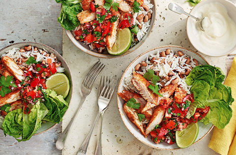 Loaded with spiced basa fillets, fried rice and beans, a refreshing salsa, lettuce leaves and an optional dollop of soured cream, these deconstructed fish burritos take bowl food to a whole other level