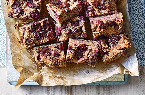 A tin of cannellini beans sounds unusual in blondies, but combined with cashew butter and maple syrup this gives a luxurious dairy-free result that can be blitzed together in no time. Fresh raspberries and a touch of chocolate add familiar sweetness for an