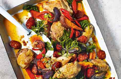 This Mediterranean-inspired chicken traybake is sure to become a new family favourite. Everything roasts in the oven for an easy hands-off meal with spicy chorizo, colourful veg and a touch of honey that becomes a wonderful sticky marinade for the chicken.