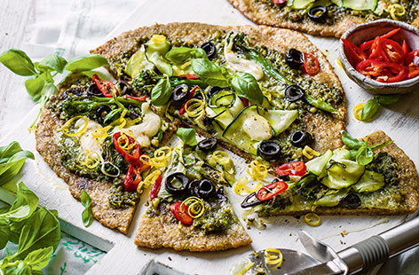 Make homemade pizzas in 30 minutes with this easy midweek recipe. The simple base uses just two ingredients – yoghurt and wholemeal flour – and is topped with vibrant pesto, charred broccoli and delicate courgette ribbons for a green twist on a classic.