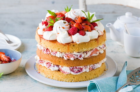 Inspired by a classic Eton mess, this elegant layered sponge cake is filled with all our favourite ingredients, from macerated strawberries and raspberries to whipped cream and crunchy meringue.