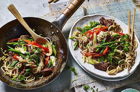 Swap your Friday night takeaway for a speedy homemade version. This pork noodle stir-fry is ready in just twenty minutes – quicker than a delivery! Using Chinese five-spice means you don't have to juggle lots of individual herbs and spices.