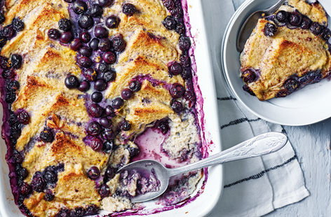 For a fresh spin on a British classic, here we make bread and butter pudding with sweet fruit jam and studded with fresh blueberries. This sweet pud also happens to be dairy free and vegetarian. Serve with your favourite sides.