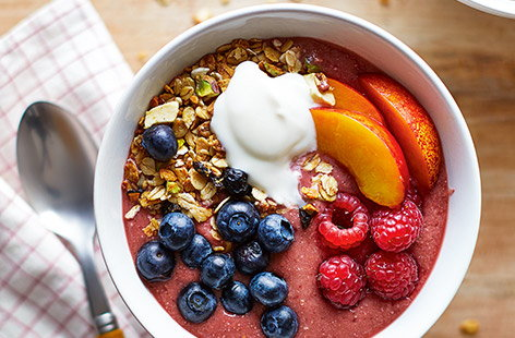 Enjoy this super quick, fruity smoothie bowl for breakfast. Blitz together fresh berries, juicy nectarine and granola before topping with yoghurt and more fruit for a bright breakfast ready in five minutes.