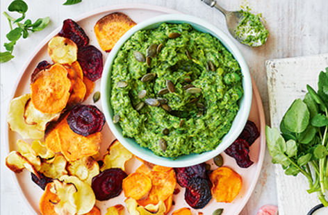 With its strong peppery flavour and bright green hue, watercress adds a flavour punch to this creamy guacamole. Make your own crisps at home - simply bake slices of beetroot, sweet potato and parsnip for a healthy spin on the classic snack