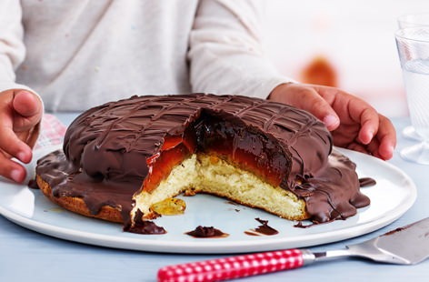 Little ones will love helping to make this giant version of the classic jaffa cake. A light and springy sponge base is topped with chilled orange jelly, which is then covered in a layer of melted dark chocolate and set to create the crunchy outer layer