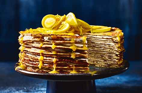 Look no further for a unique, dinner party dessert! This layered crêpe cake stacks lacy pancakes topped with a tangy, lemon curd swirled yoghurt for a striking pudding that easily feeds a crowd
