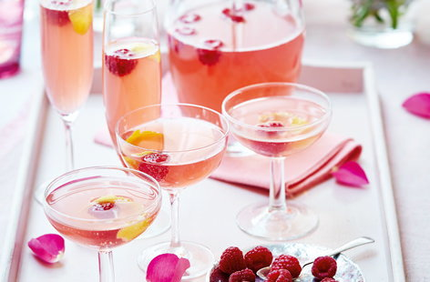 Starring sweetly-tart raspberries, fizzy pink lemonade and a zingy lemon peel garnish, this cocktail is perfect for enjoying with friends