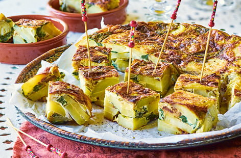 These Spanish tortilla bites, studded with spinach and artichoke, are the ultimate tapas dish and are perfect for feeding a crowd