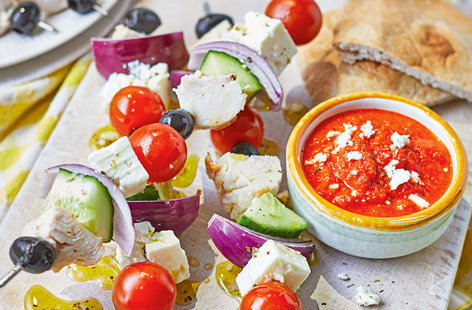 These inventive Greek salad kebabs are the perfect weeknight supper for two. This assembly-only recipe means that no time is wasted in the kitchen - simply blitz up the red pepper dip, construct your kebabs and enjoy