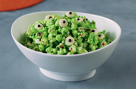 Spooky, slimy and super snackable, this oozy green popcorn with googly eyes is the perfect Halloween party food for kids and adults alike.