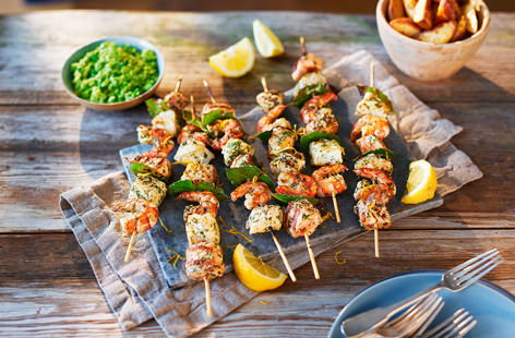 Marinated in a mix of lemon juice, garlic and green herbs, these fish and king prawn kebabs taste incredible served straight off the barbecue with a scattering of fresh lemon zest