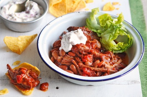 This seriously comforting summertime supper can be ready in under an hour. Tender pulled beef takes on the sticky sweetness of smoky barbecue sauce and hearty pinto beans add nutritious bite