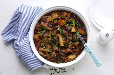 Steak that's slowly cooked until it's so tender, chunky root vegetables and a generous glug of red wine make this casserole the perfect weekend dinner.