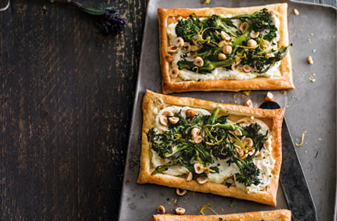 Seasonal purple sprouting broccoli is sweet in flavour and lends such a pretty vibrancy to dishes. Top puff pastry with creamy goat's cheese, toasted hazelnuts and roasted broccoli for a delicious lunch on the go.