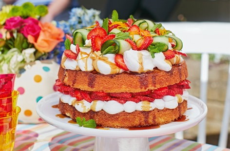 A showstopping summertime bake – Pimm's-soaked sponge sandwiched with mascarpone cream and topped with fresh strawberries and cucumber