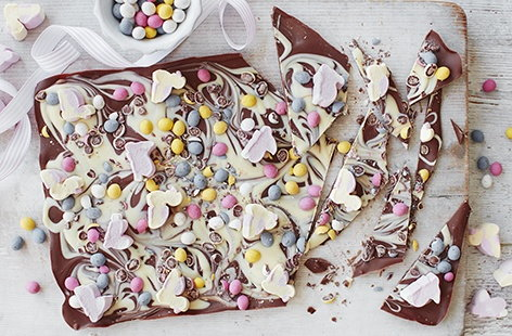 Made with swirls of milk and white chocolate and topped with pastel-coloured chocolate eggs and mini mallow bunnies and chicks, this Easter egg bark makes a lovely edible gift or indulgent snack