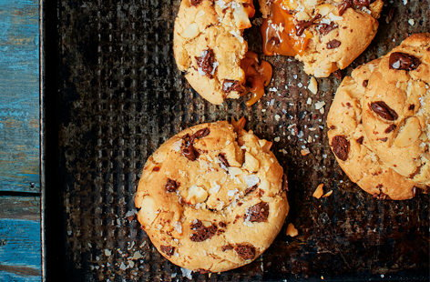 Serve these cookies freshly baked and still warm to truly experience the gooeyness of the caramel centres and the deliciousness of the melt-in-the-mouth chocolate chips.