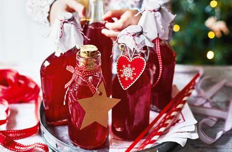 Tart cranberries, zingy lemons and caster sugar combine in this delicious cordial, a wonderfully festive edible gift idea that even the little ones can get involved with