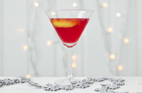 This pretty, pink martini is sure to make your party guests blush! Made with lemon and cranberry juice, maple syrup, vodka and Angostura bitters, this punchy martini is sure to get the party started.