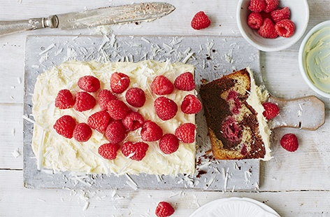 A match made in heaven – this decadent marble cake swirls creamy white chocolate and rich dark chocolate cake batter together and is dotted with bursts of tart raspberry, which cuts through the sweetness perfectly