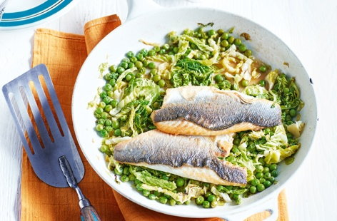 Buttery sea bass fillets with cider-braised greens