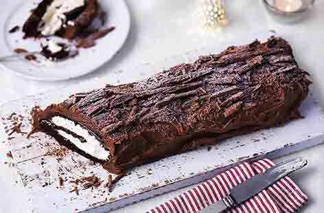 Slice into this beautiful Christmas dessert to discover the spongey, cream centre that's hidden beneath lashings of rich chocolate icing. The flaky chocolate bark topping makes this traditional yule log even more deliciously special
