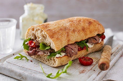 Make the most of your leftovers with this, the ultimate beef sandwich which layers griddled garlic ciabatta with a dollop of horseradish, roasted tomatoes and slices of leftover roast beef
