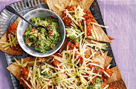 This Mexican-inspired dish is perfect for sharing! With crisp tortillas, spicy mixed beans, homemade avocado salsa and plenty of mature Cheddar, this easy nachos recipe takes just over half an hour to make but is sure to be devoured in minutes