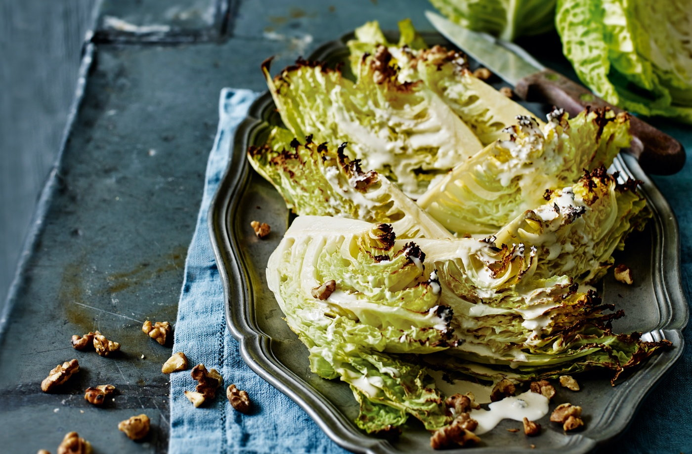 Roasted Savoy cabbage wedges with blue cheese dressing and walnuts recipe