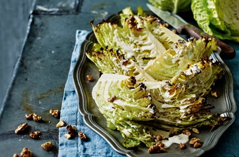 Roasted Savoy cabbage wedges with blue cheese dressing and walnuts