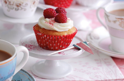 These delightful cupcakes are perfect for a summer street party or celebration. Made with raspberries and then topped with raspberries and a cream frosting, they are sure to impress. Add a touch of sparkle with some edible glitter.