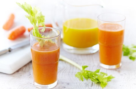 Fresh orange, carrot and celery juice