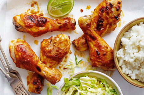 Peanut chicken drumsticks with rice and cabbage