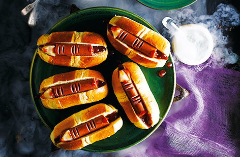 For a quick and easy Halloween snack, rustle up these simple spooky fingers made with tasty hot dog sausages and sweet brioche rolls. The ideal Halloween party idea - a bit of clever crafting and this classic meal is transformed into a scarily good dish