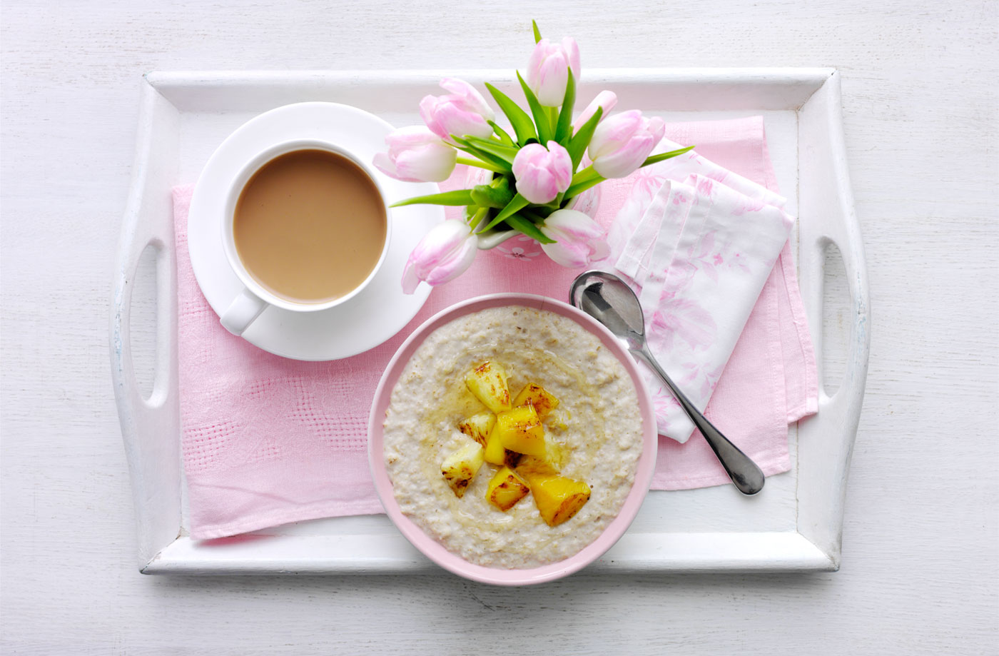 Slow-cooked coconut porridge with warm tropical fruit