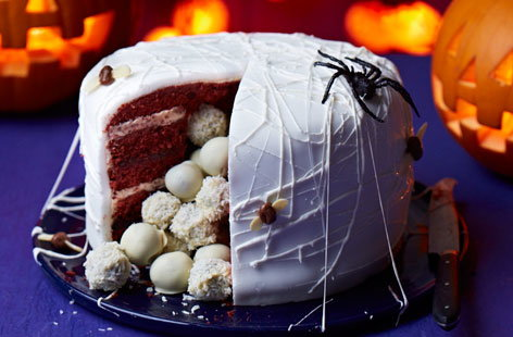 Halloween is the perfect time for pushing the boat out with your confectionary creations. This spider's nest cake might be spooky on the outside thanks to some nifty decoration but its delicious surprise cake ball interior is anything but.
