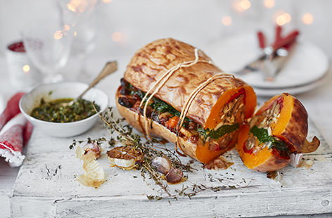 Prepare this stunning centrepiece to impress your vegan guests on Christmas day. Roasting a whole butternut squash, scooping out the sweet flesh and then filling with layers of chargrilled peppers, mushroom, chestnuts and spinach is really easy to do