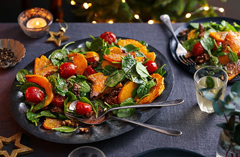 If you're looking for a simple Christmas starter to serve this year, try this colourful roasted squash salad. With roasted tomatoes, fresh spinach and a festive pomegranate dressing, this vegan and gluten-free starter can kick off your Christmas dinner for everyone.