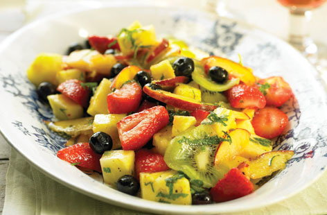 Summer fruit salad with mint and olive oil