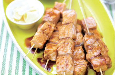 Salmon teriyaki kebabs take no time to prepare and cook in minutes. Skewered chunks of salmon are brushed with a garlic, ginger, honey, soy sauce and sesame glaze, then baked under the grill until juicy and cooked-through.