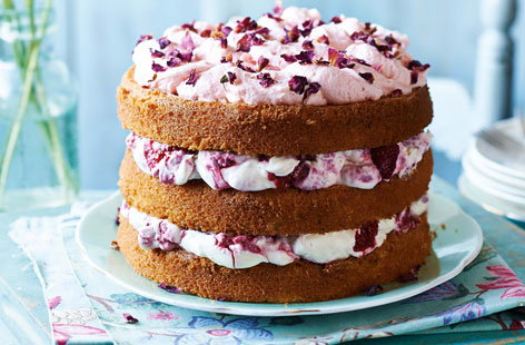 Raspberries and cream cake with rose petals