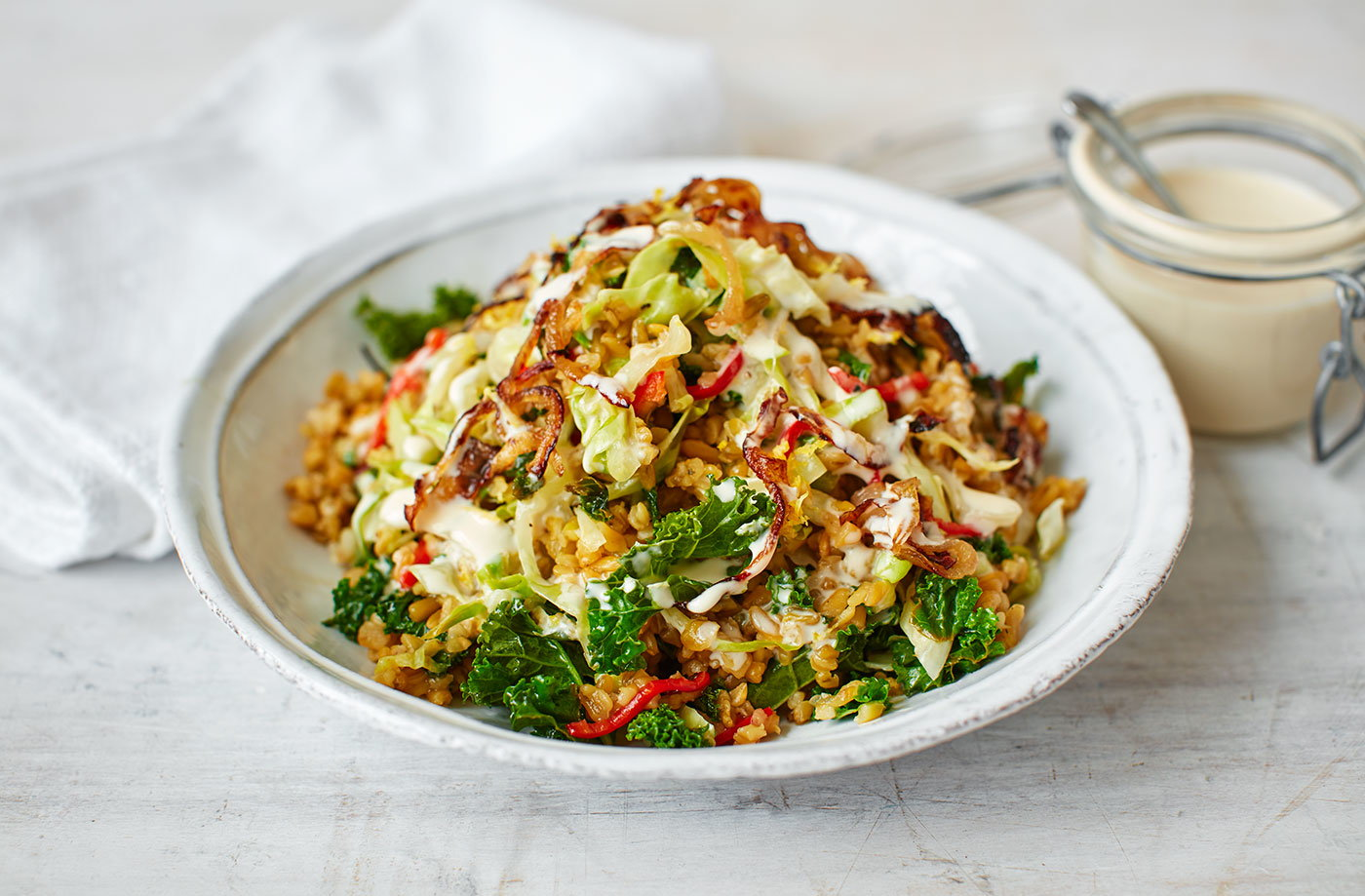 Grains, stir-fried greens and tahini dressing recipe