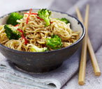 Coconut noodles with broccoli and sesame seeds
