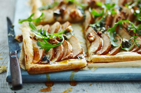 For a delicious starter and spin on the classic pear, walnut and roquefort salad, try this impressive-looking tart at your next dinner party. The three, classic ingredients are arranged on puff pastry then baked in the oven until the pastry is golden and crisp.
