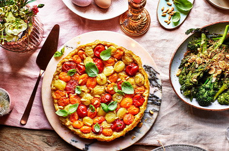 This vegan and dairy-free tart shows what you can do with a simple bit of rough puff pastry and a few mixed tomatoes