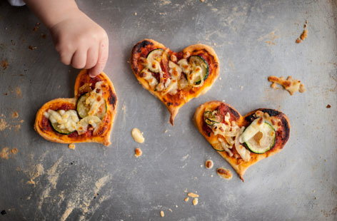 We love pizza, and we're sure the whole family will love getting involved in making these kitsch heart-shaped pizzas. They're the perfect way to introduce the kids to the kitchen and a great way to show your loved ones how much you care.